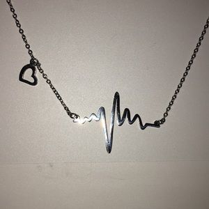 Very detailed heart beat necklace